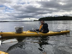 Kayak lake cleanup with Dane County Parks in Madison, WI.
