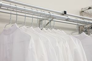 Lab coats lined up and ready for the many people who will work at the facility.