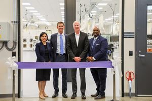 (L to R): Ana Hooker, Kevin Conroy, Rich Lynch and Dr. Ruben Anthony stand in front of ribbon in front of lab door at Nexus One grand opening event.