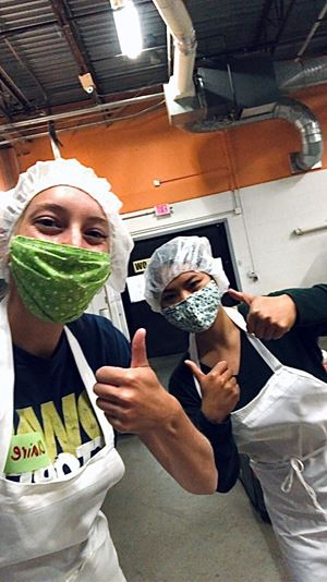 Aurora Greane and Claire Mitchell, Service & Support Interns, helped out at the Second Harvest Food Bank in Madison by bagging avocados and sorting tomatoes to be donated to families in need.