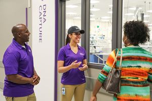 Tour hosts speak with guests about the laboratory's operations.